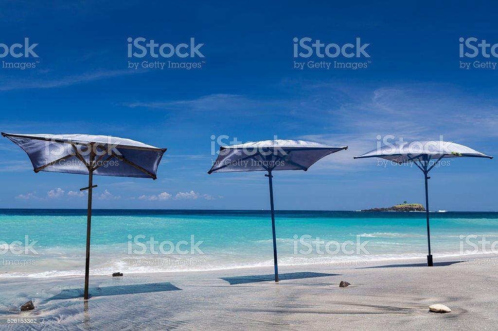 Beach umbrella on the tropical island of Bali stock photo