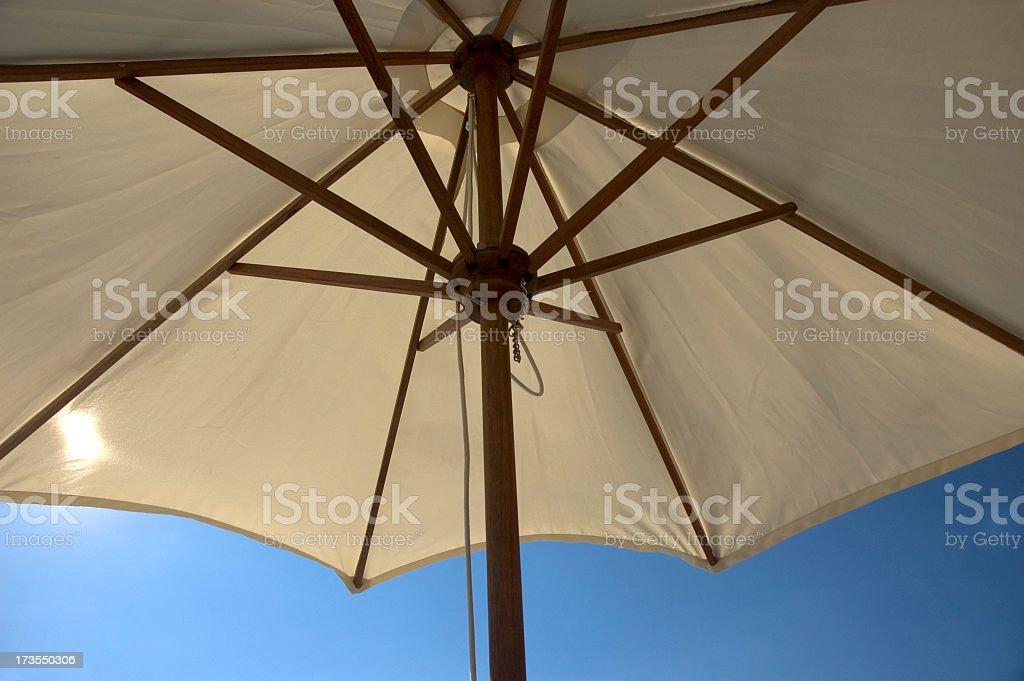 Beach umbrella raised in the sun royalty-free stock photo