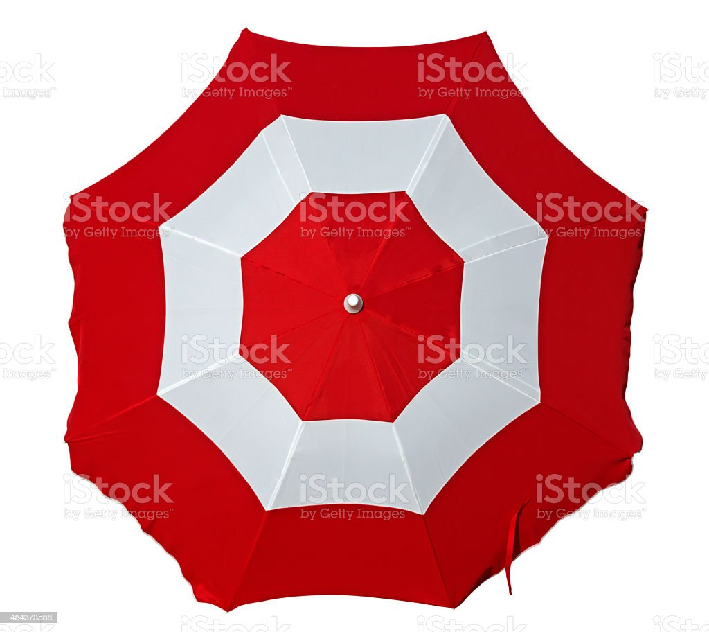 Beach umbrella with red and white stripes stock photo
