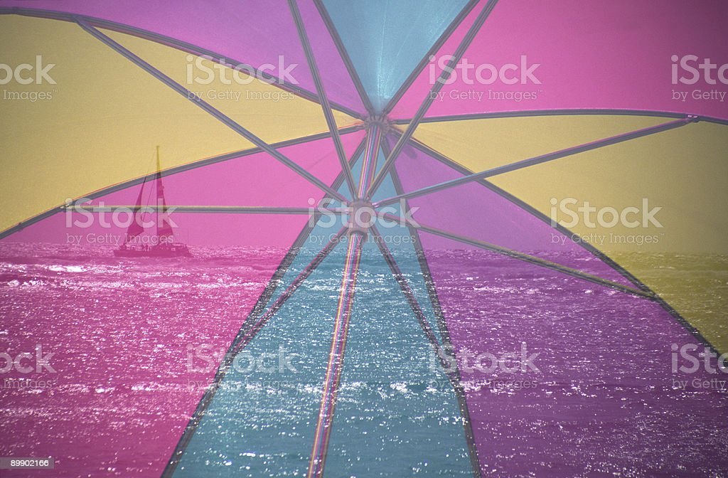 Beach umbrella with yacht royalty-free stock photo