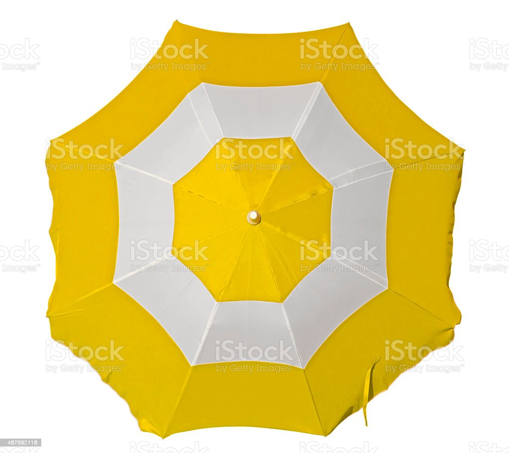 Beach umbrella with yellow and white stripes stock photo