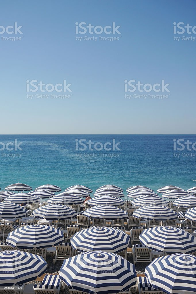 Beach umbrellas and sun loungers on a beach stock photo