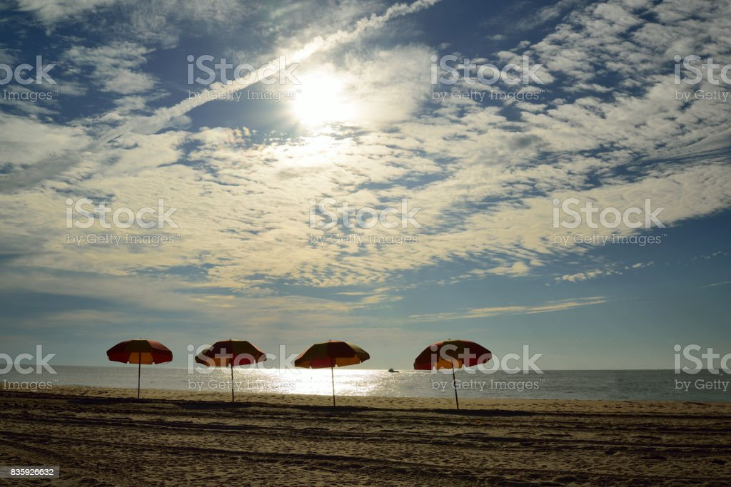 Beach Umbrellas at Dawn stock photo