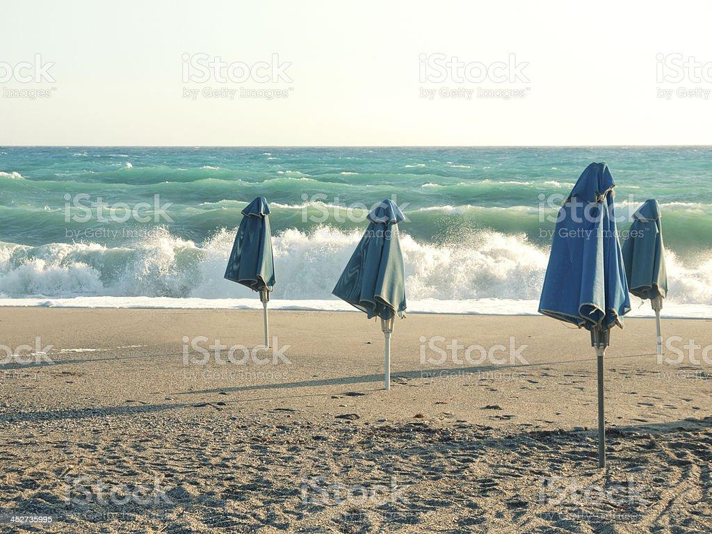Beach umbrellas in heavy weather stock photo