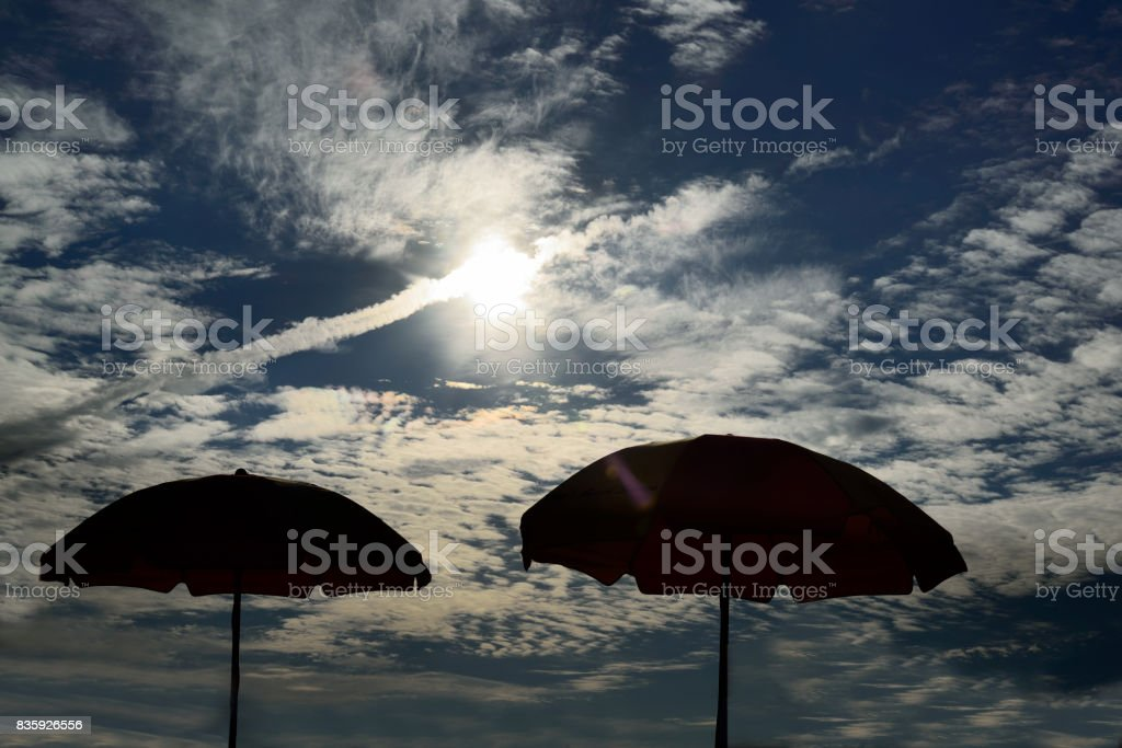 Beach Umbrellas Silhouettes stock photo