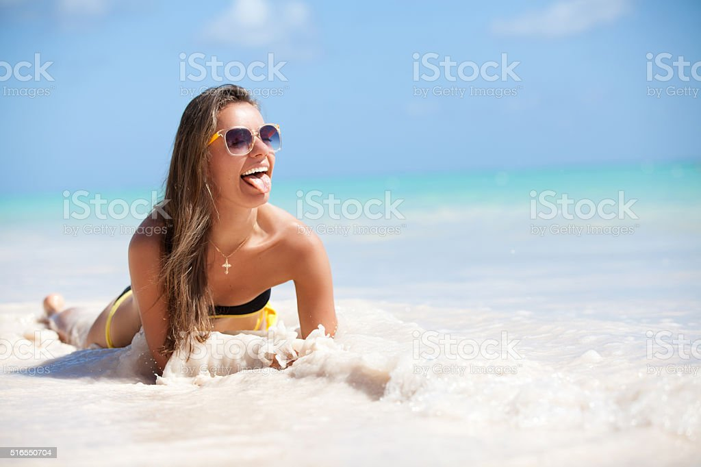 beach vacation woman relaxing on sand happy stock photo