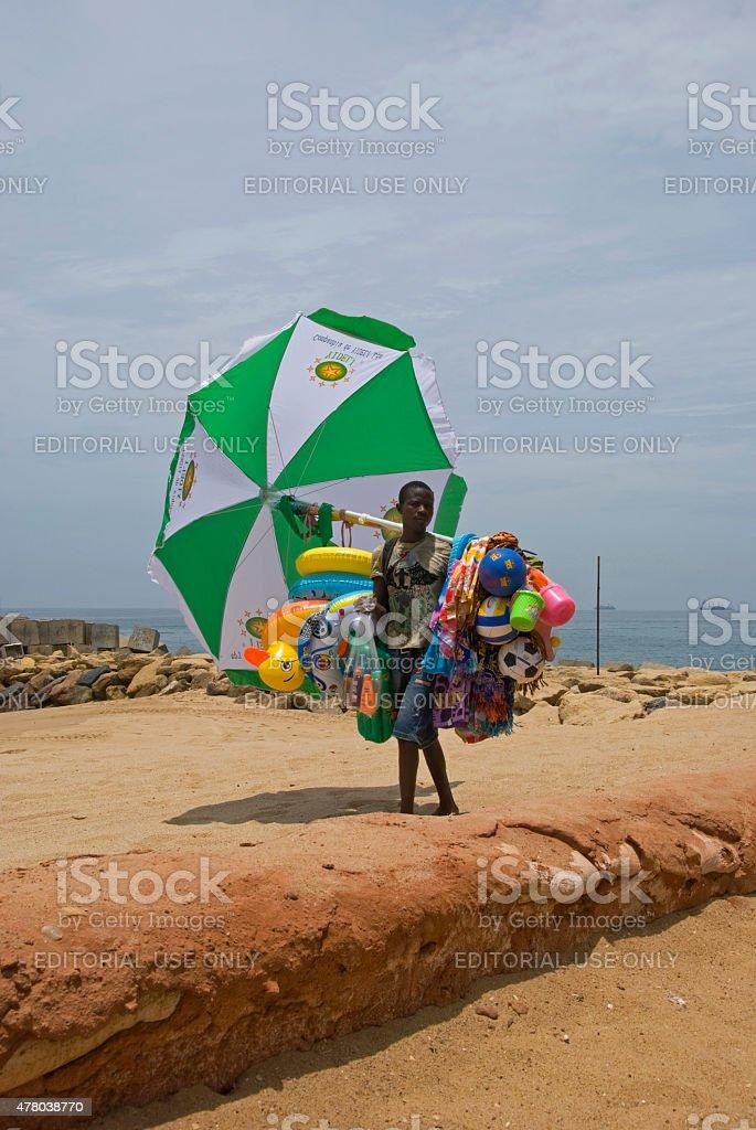 Beach Vendor with beach toys in Luanda stock photo