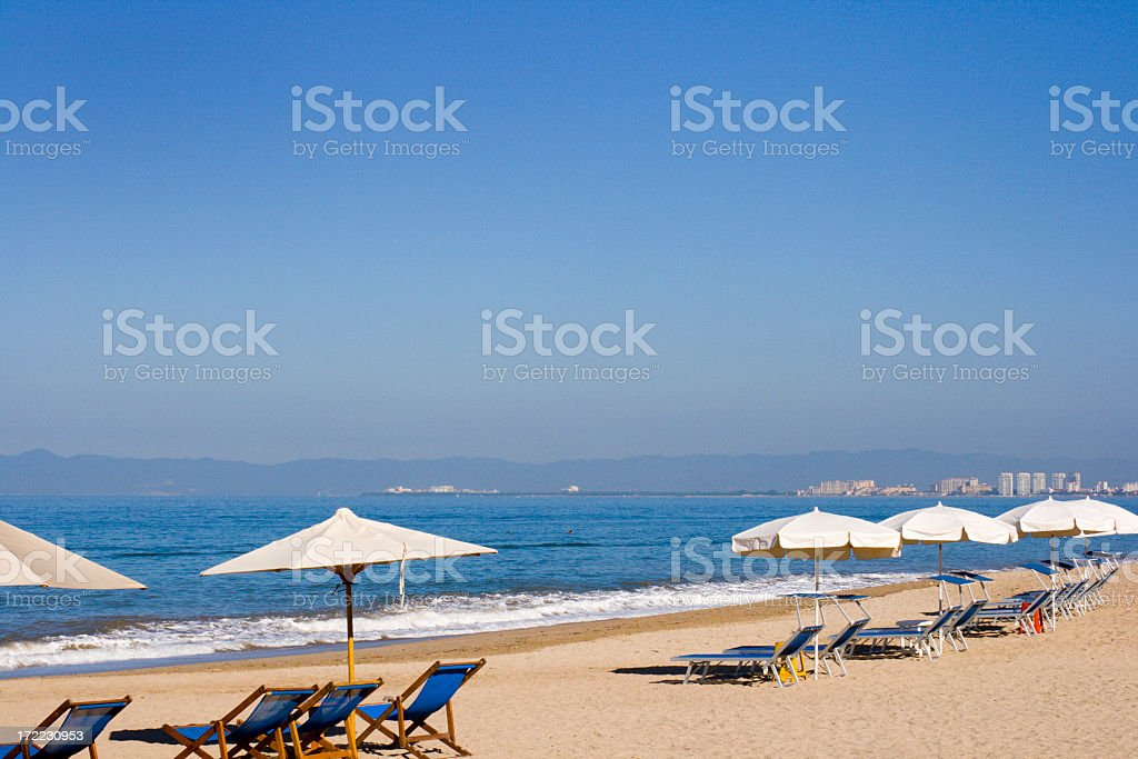 Beach View at Puerto Vallarta, Mexico with Chairs and Umbrellas stock photo