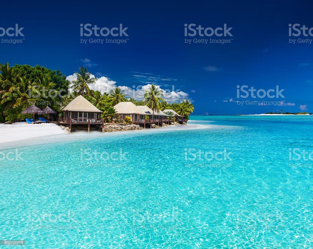 Beach Villas on small tropical island stock photo