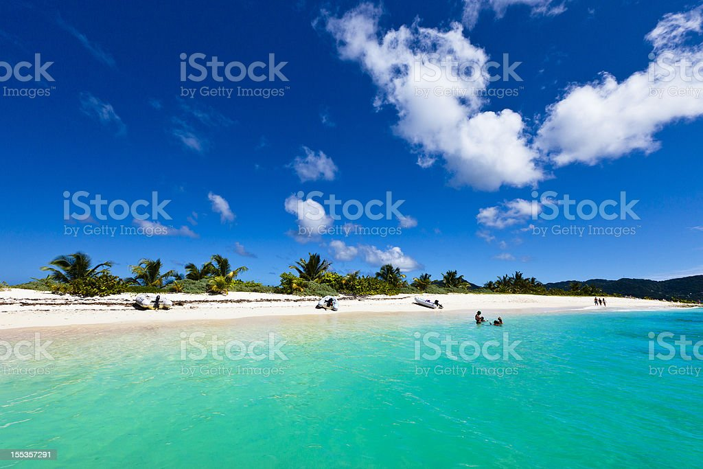 Beach visitors enjoying the weather on Sandy Island, Grenada stock photo