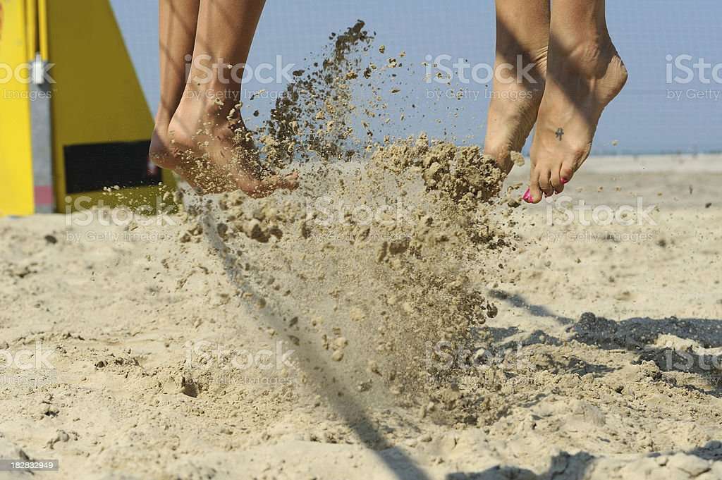 Beach volley action in mid-air royalty-free stock photo