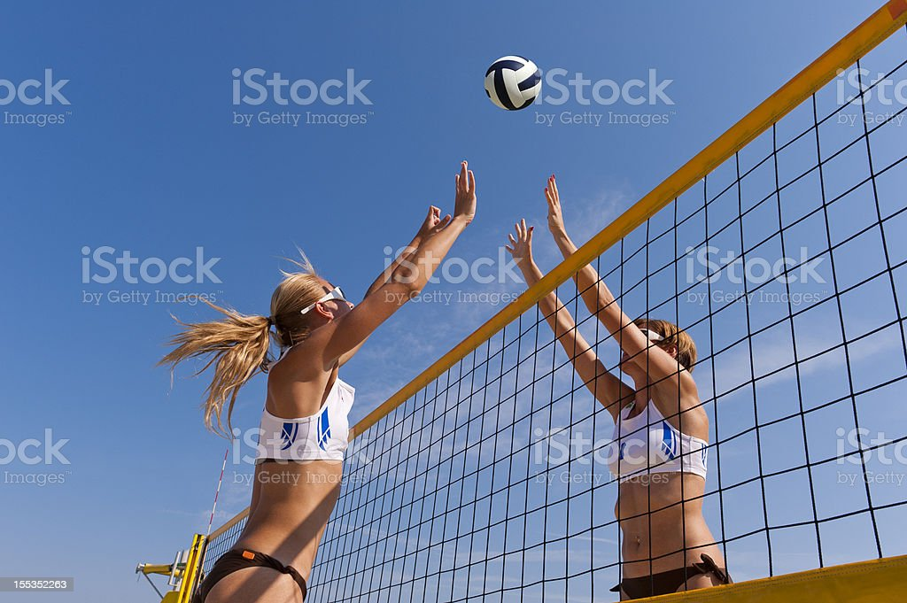 Beach volley action on the net stock photo