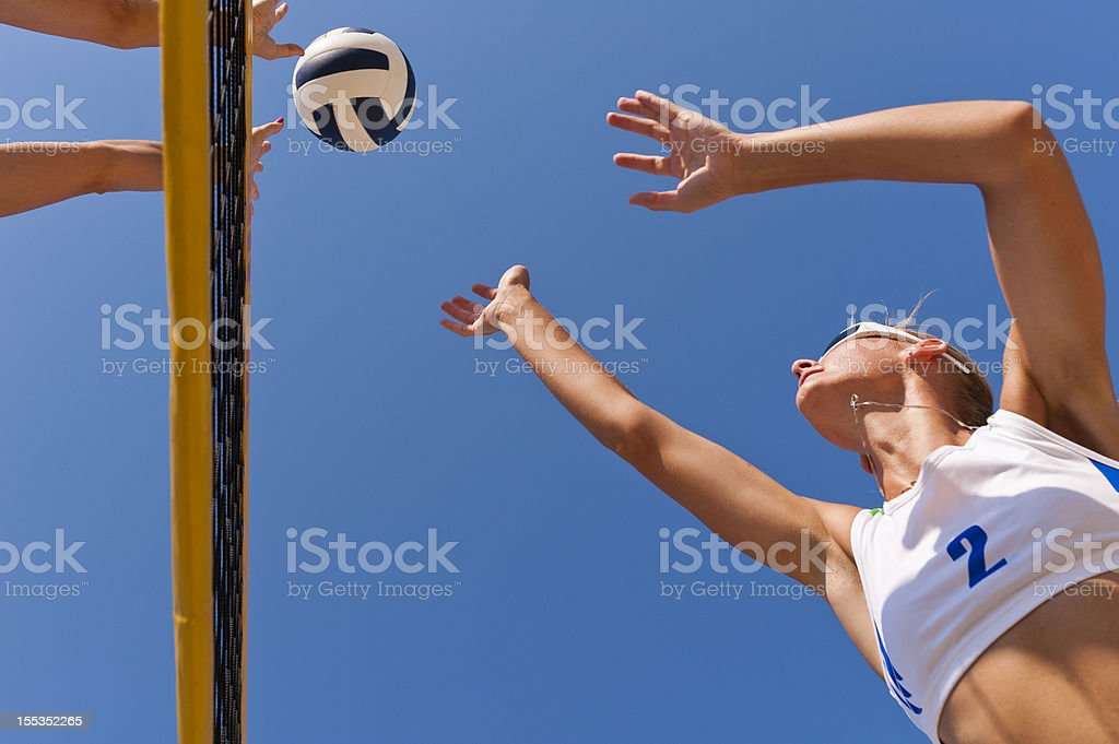 Beach volley action on the net royalty-free stock photo