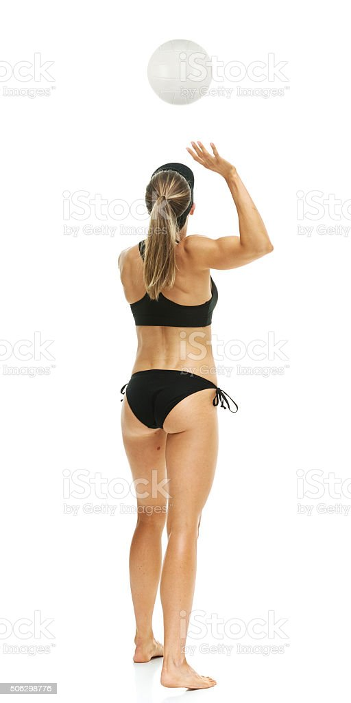 Beach volley ball player in action stock photo