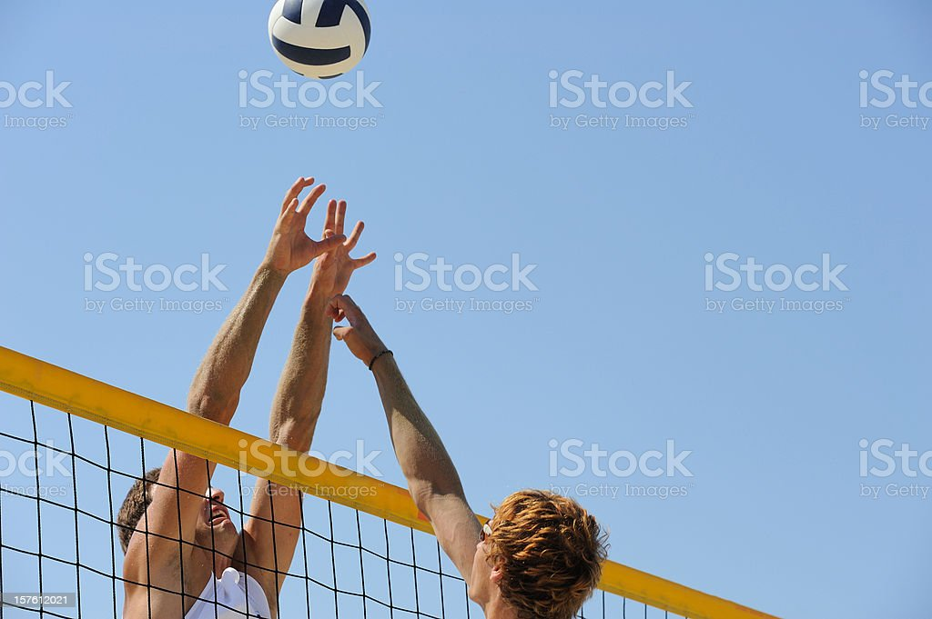Beach volley block action on the net royalty-free stock photo