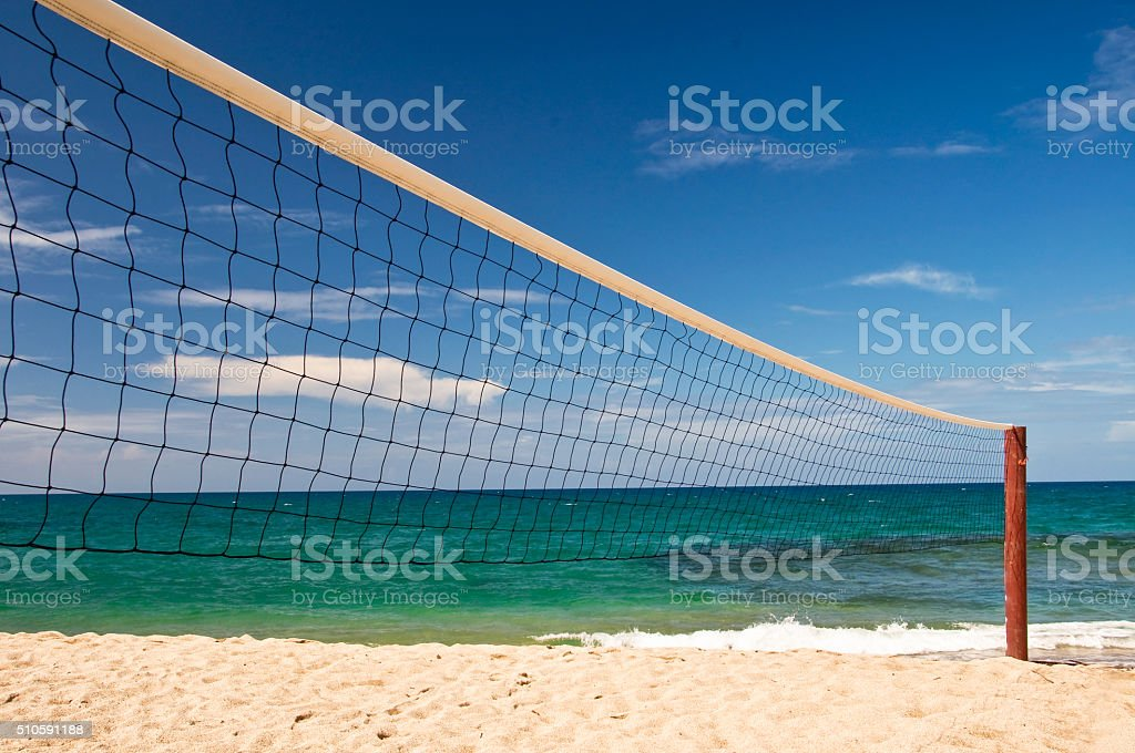 Beach volley net, blue sky and sea in the background stock photo