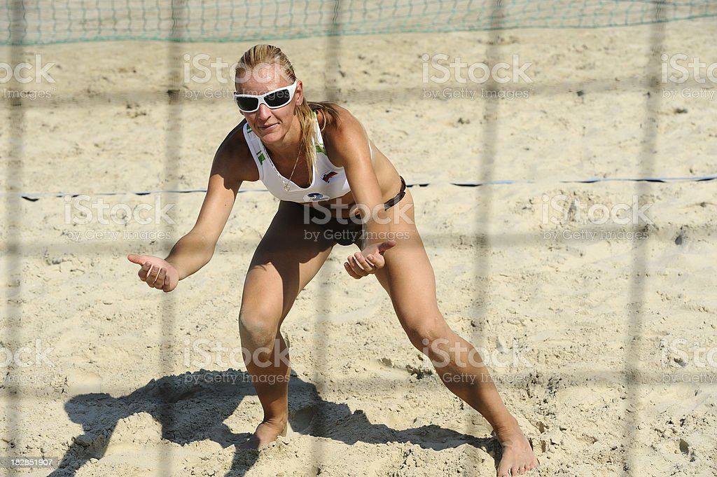 Beach volley player in defensive position royalty-free stock photo