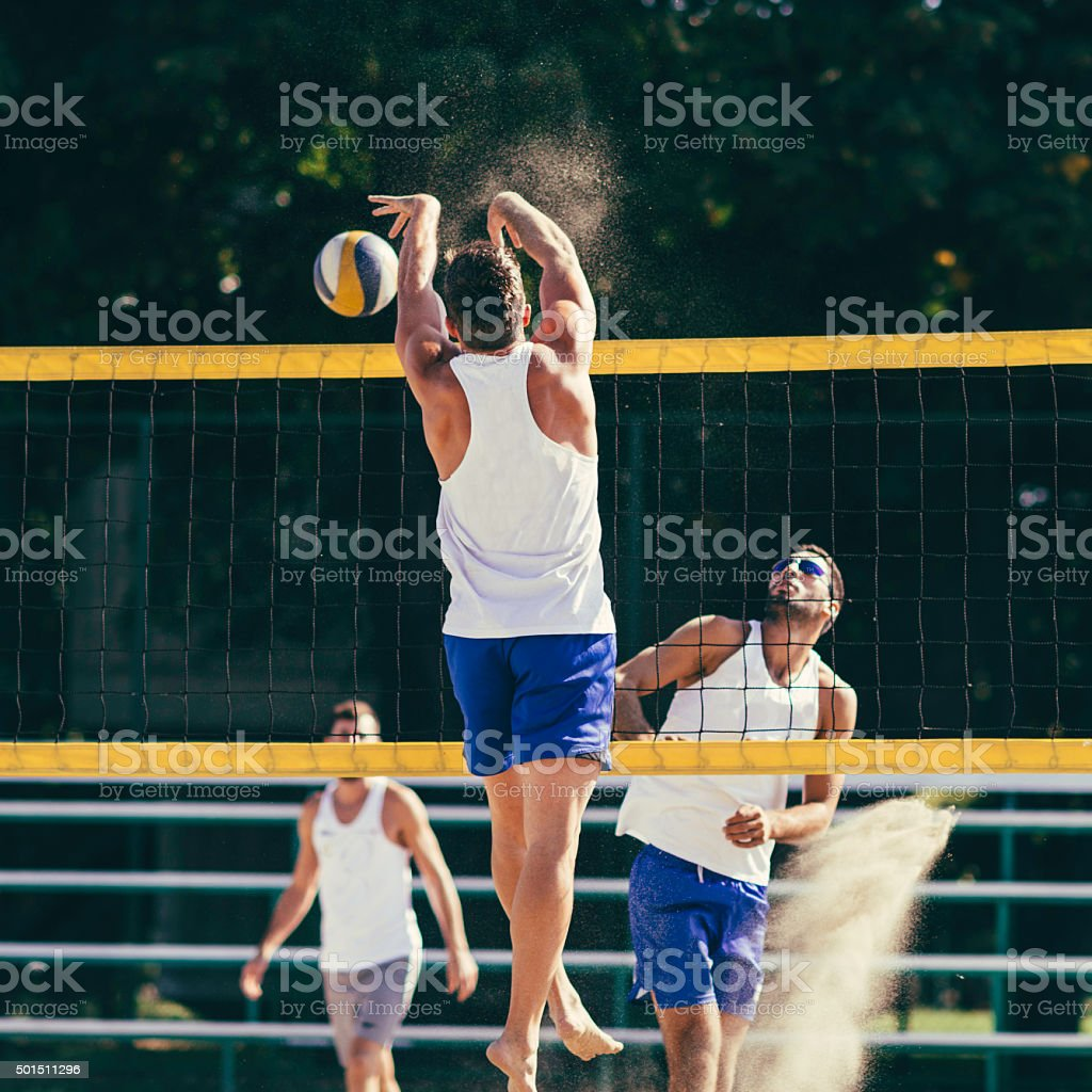 Beach volleyball action stock photo