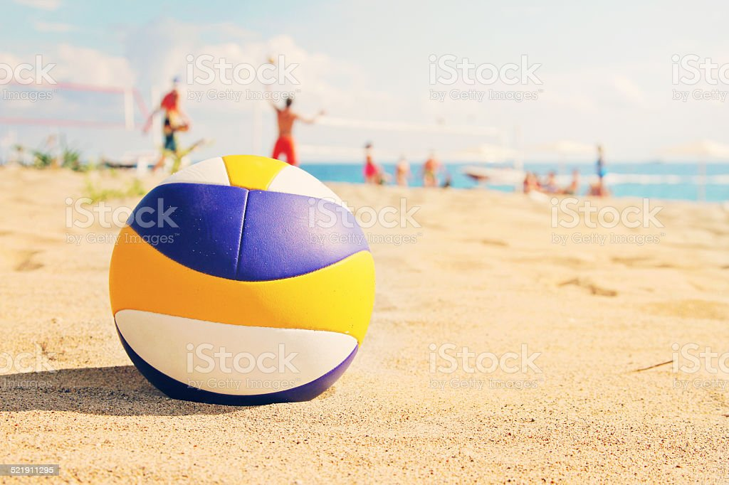 beach volleyball ball in sands stock photo