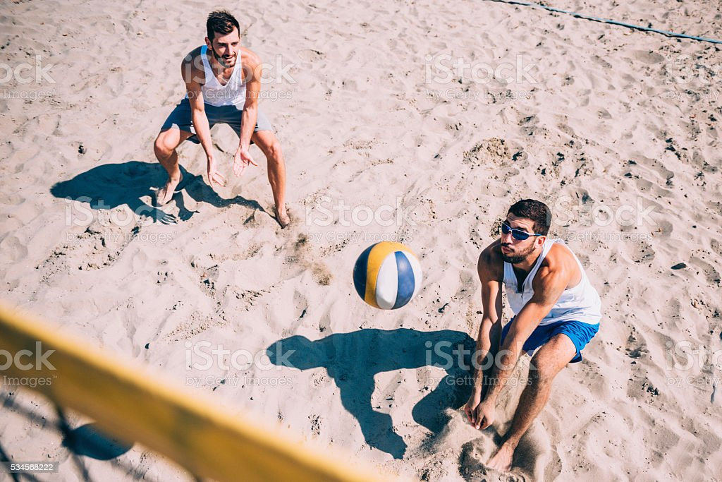 Beach volleyball competition, men playing stock photo