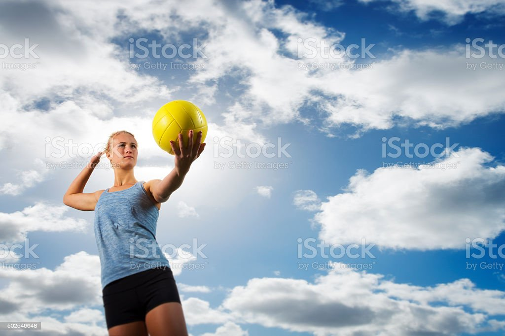 Beach Volleyball Girl Serving a Ball stock photo
