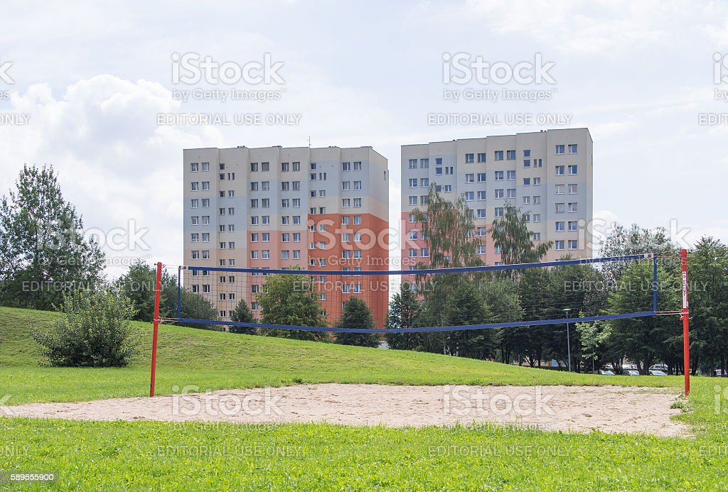 beach volleyball in front of industrialized apartment block, Jelenia Gora stock photo