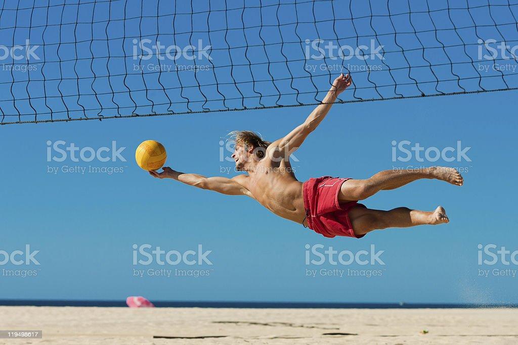 Beach volleyball - man jumping royalty-free stock photo