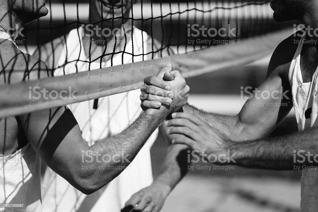 Beach volleyball men stock photo