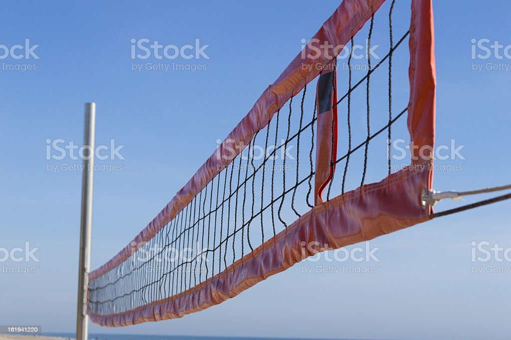 beach volleyball net in front of a beautiful royalty-free stock photo