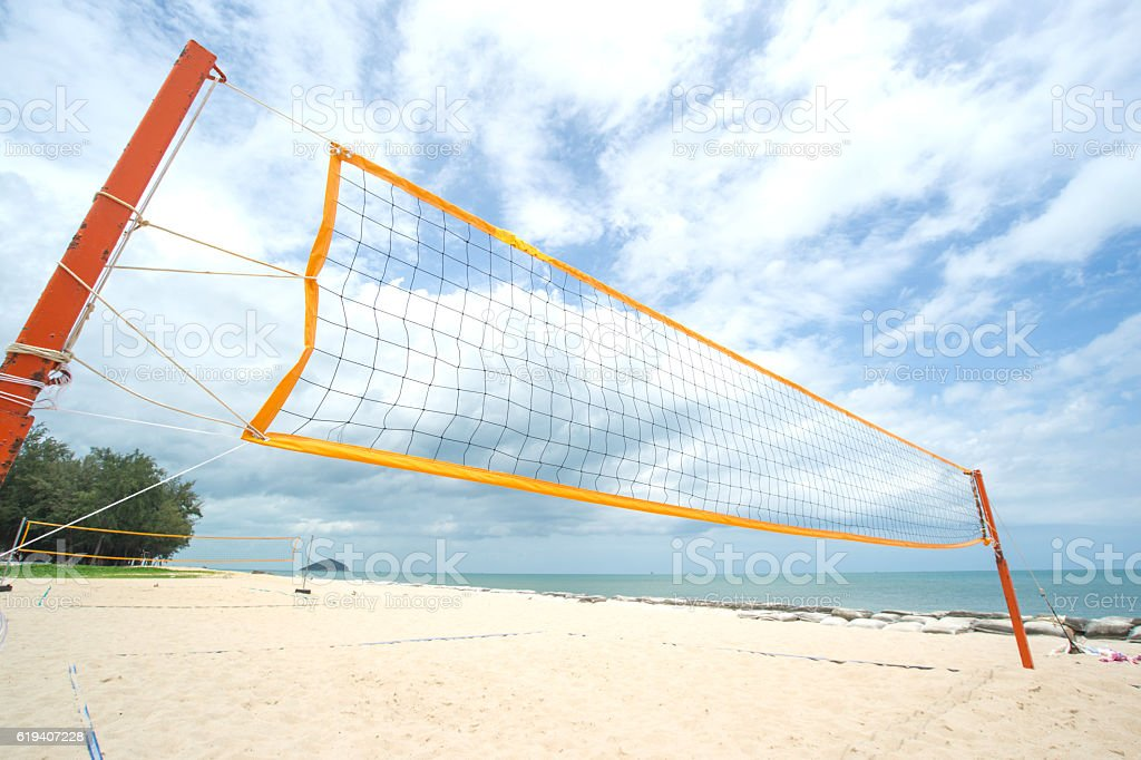 Beach Volleyball net on the beach with blue sky stock photo