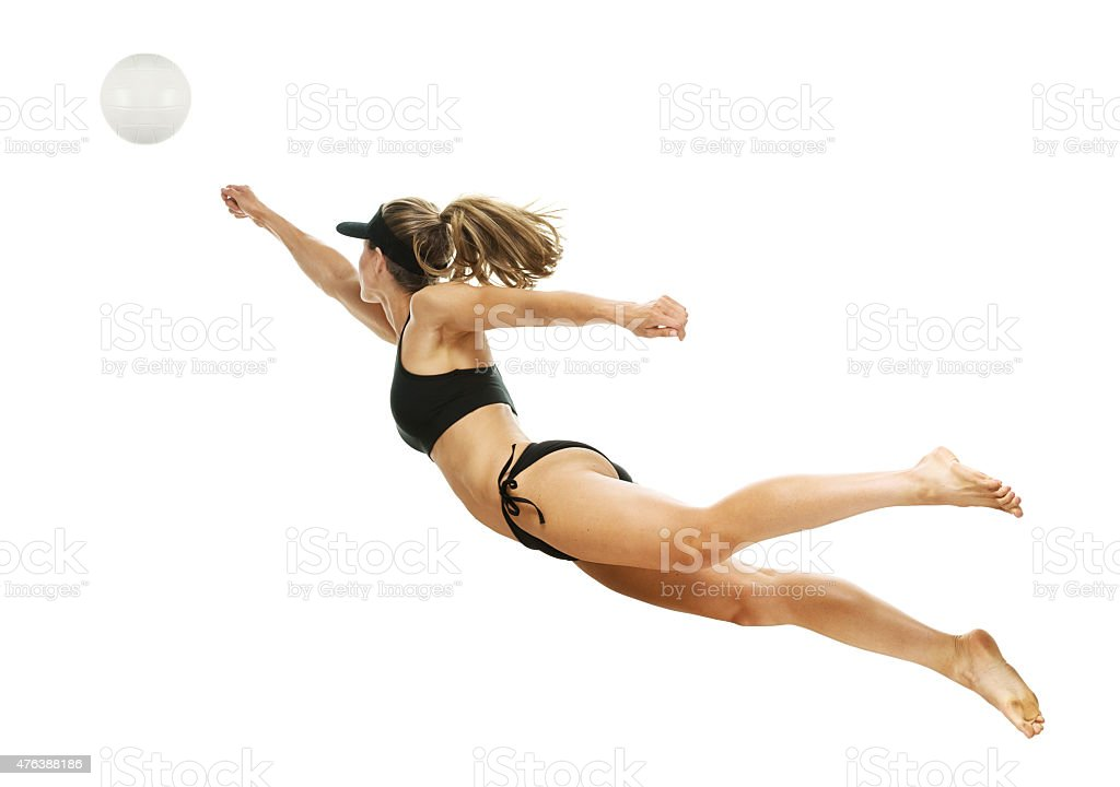Beach volleyball player in action stock photo
