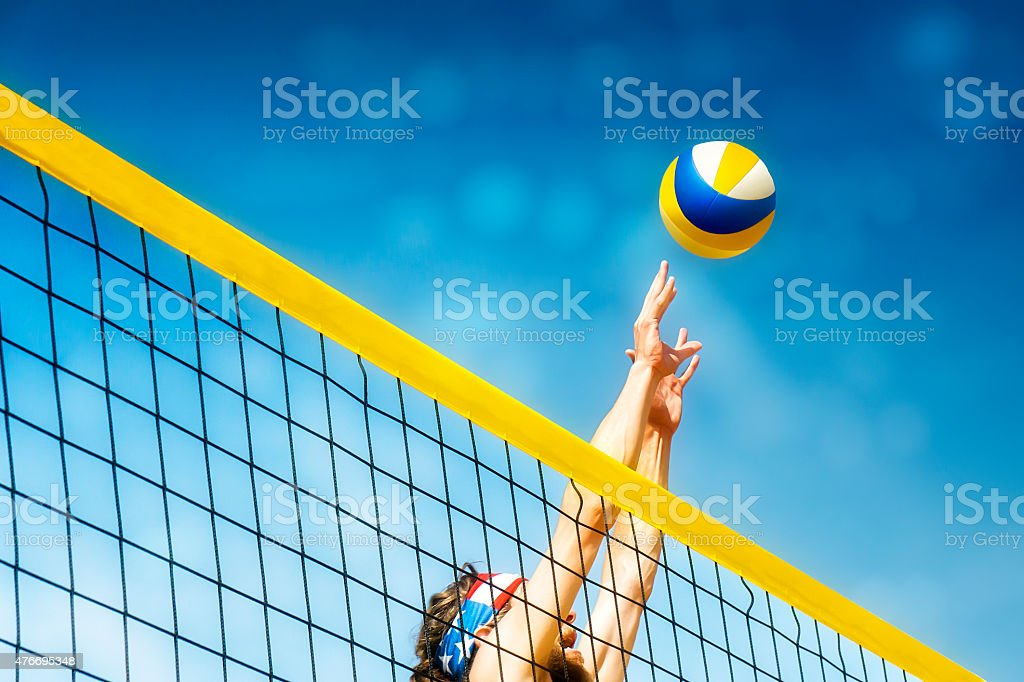 Beachvolleyball player net stock photo