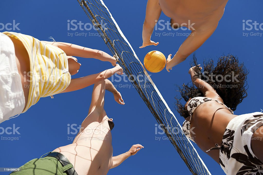 Beach volleyball - players on the net stock photo