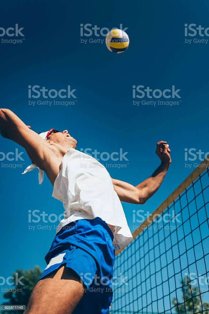 Beach volleyball spike stock photo