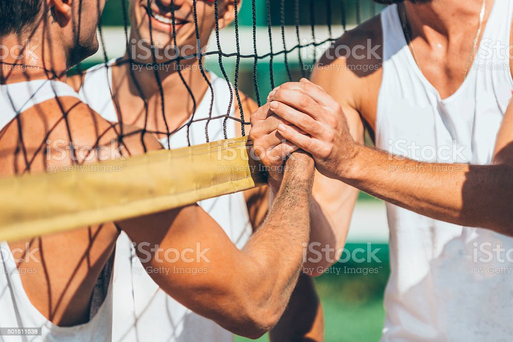 Beach volleyball teams congratulating after the match stock photo