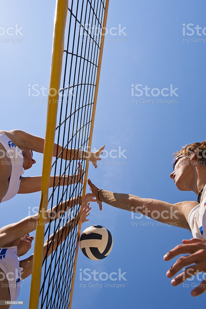 Beach volleying net action royalty-free stock photo