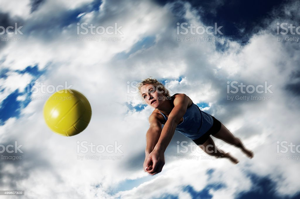Beach Volleytball Girl Diving stock photo