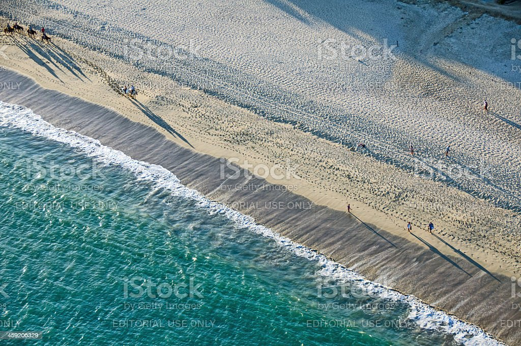 Beach Walkers From Above stock photo