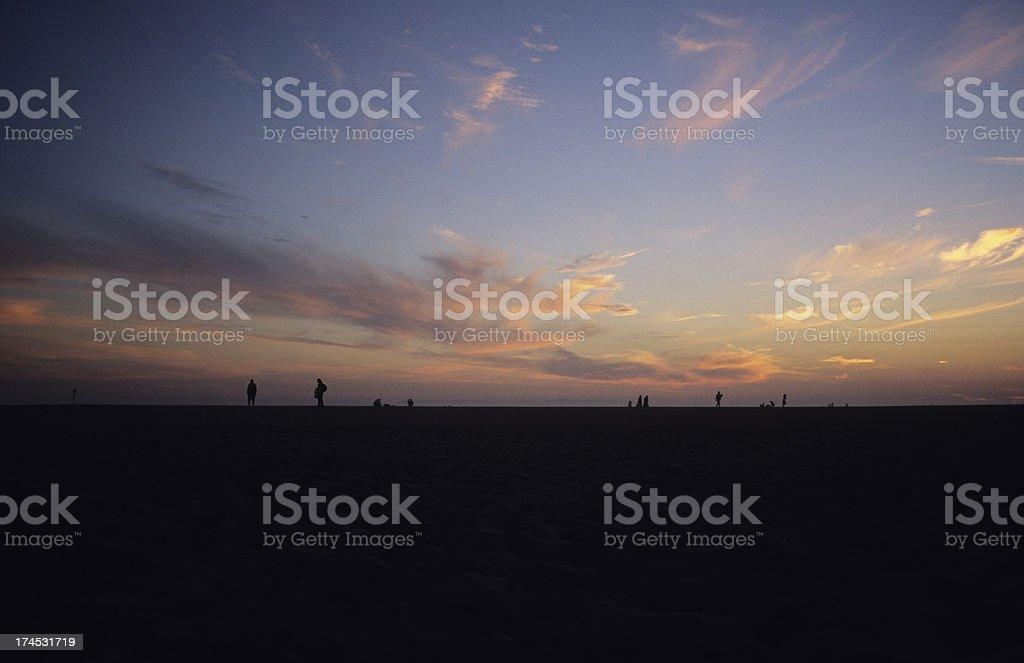 Beach walkers royalty-free stock photo