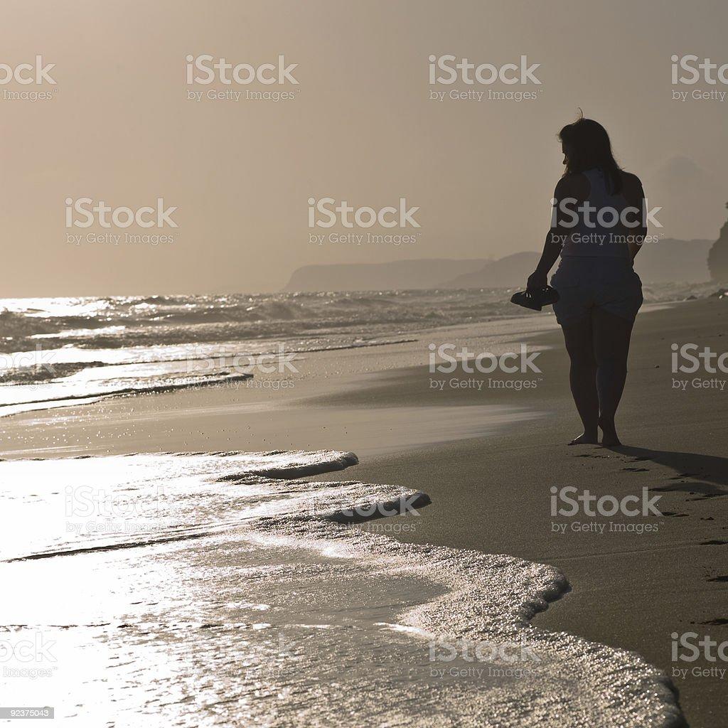 Beach walking at dusk royalty-free stock photo