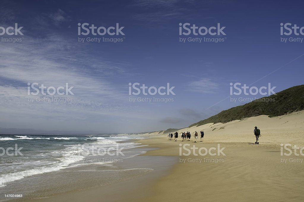 Beach walking stock photo
