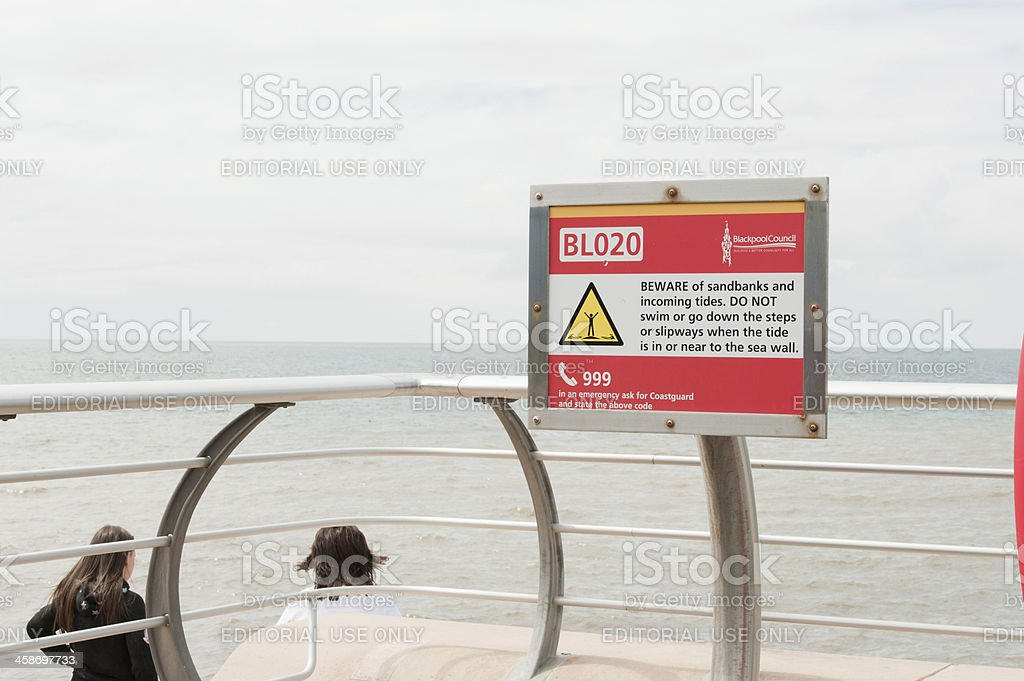 Beach Warning Sign being Ignored stock photo