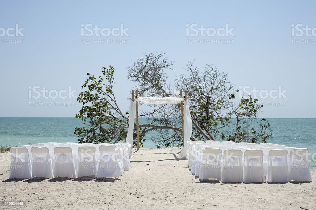 beach wedding chuppa canopy arbor and chairs facing ocean stock photo