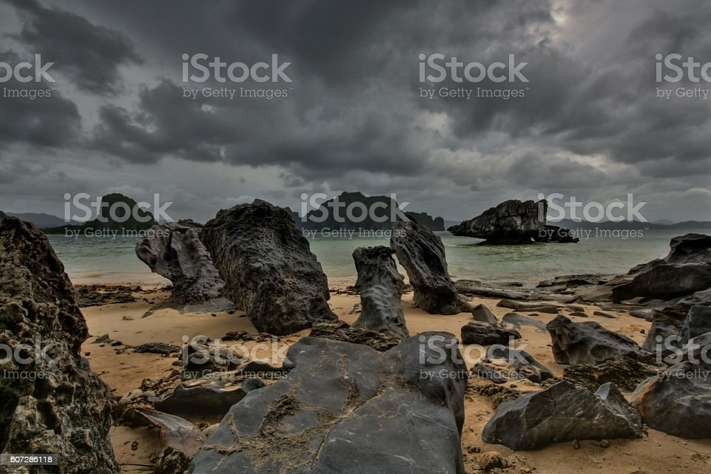 Beach with basaltic rocks and dramatic sky stock photo