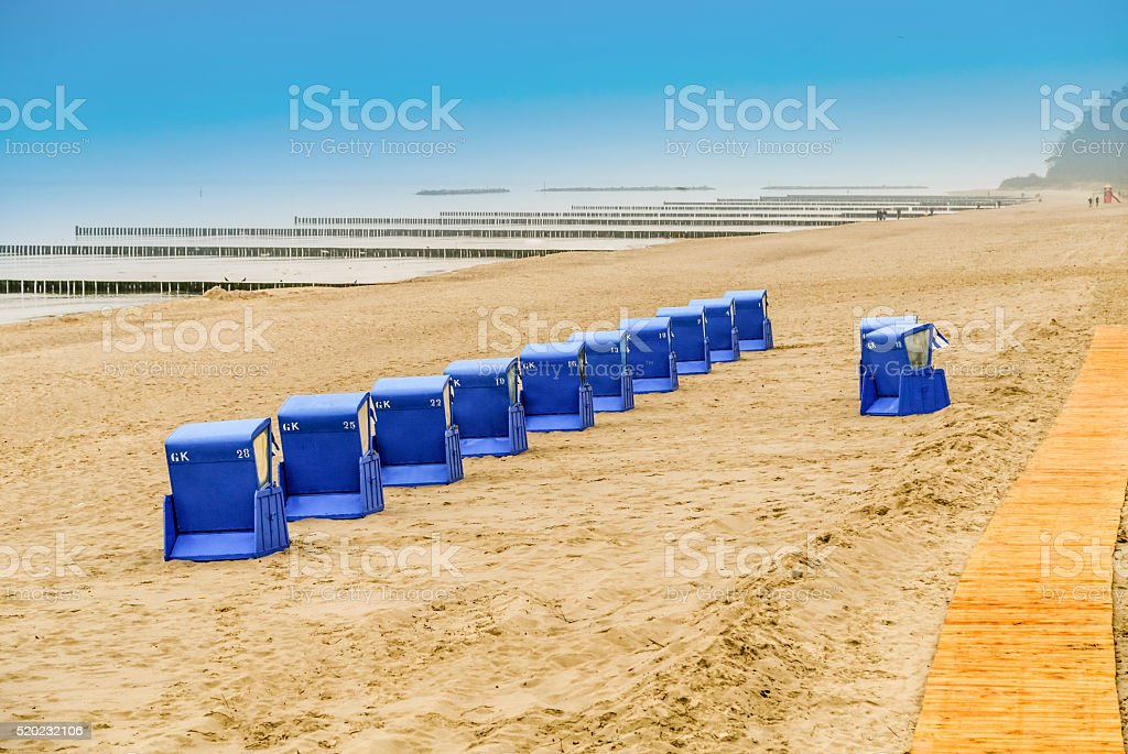 beach with beach chairs of baltic sea in the evening stock photo