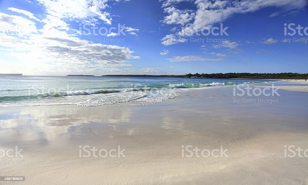Beach with cloud reflections stock photo