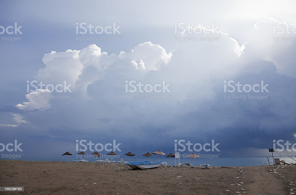 Beach with damaged Umbrellas after severe Weather royalty-free stock photo