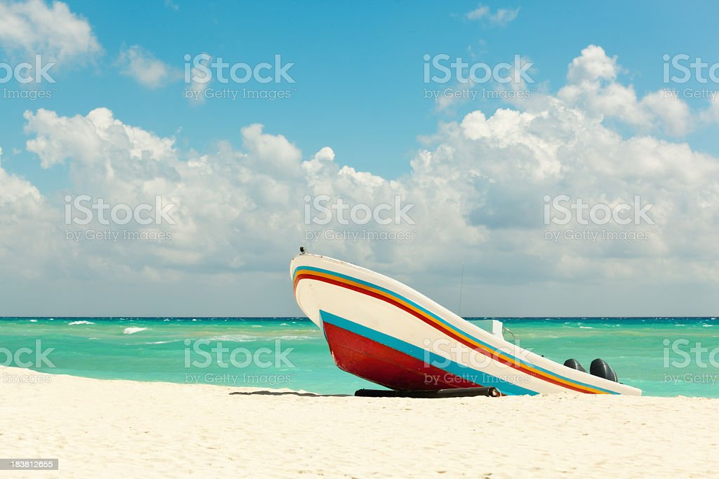 Beach with Fishing Boat on Caribbean Sea, Playa Del Carmen stock photo