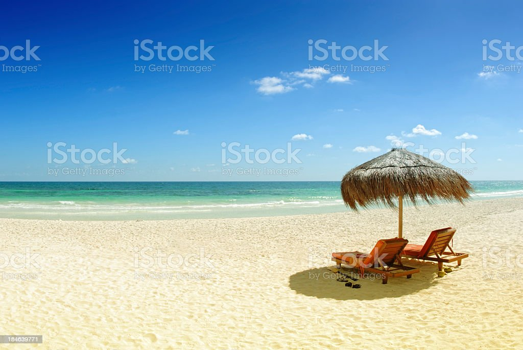 Beach with gold sand and blue water stock photo