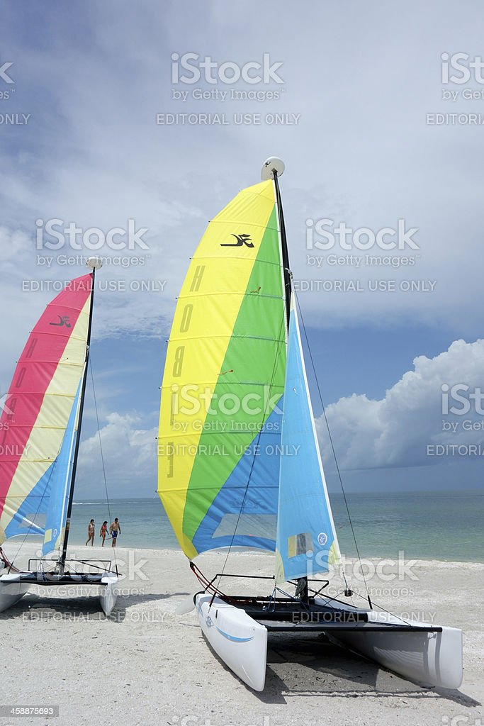 Beach with Hobie Cat catamarans stock photo